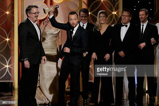 In this handout photo provided by NBCUniversal Vince Gilligan Anna Gunn Aaron Paul Michelle MacLaren and Mark Johnson accept the award for Best TV...