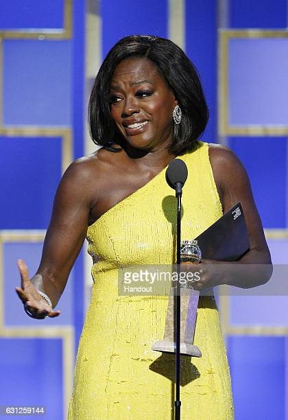 In this handout photo provided by NBCUniversal Viola Davis accepts the award for Best Supporting Actress Motion Picture for her role in 'Fences'...