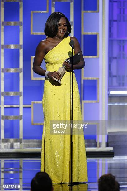 """In this handout photo provided by NBCUniversal, Viola Davis accepts the award for Best Supporting Actress - Motion Picture for her role in """"Fences""""..."""