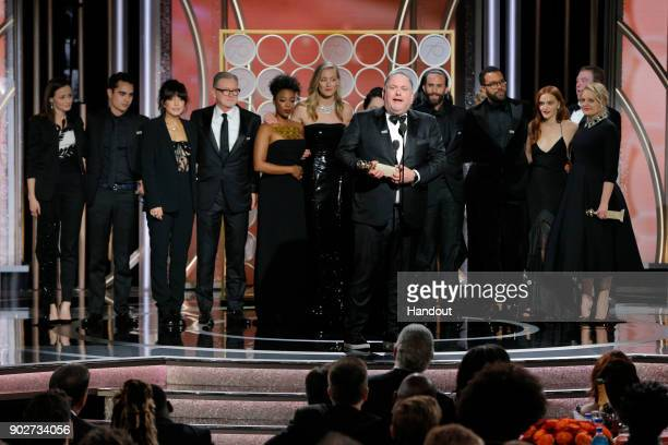 "In this handout photo provided by NBCUniversal Writer/producer Bruce Miller accepts the award for Best Television Series – Drama for ""The Handmaid's..."