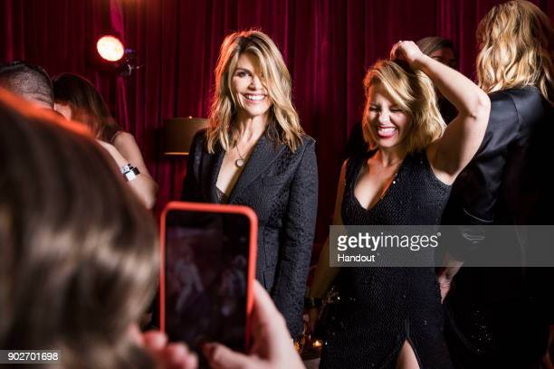In this handout photo provided by Netflix Lori Loughlin and Candace CameronBure attend the Netflix Golden Globes after party at Waldorf Astoria...