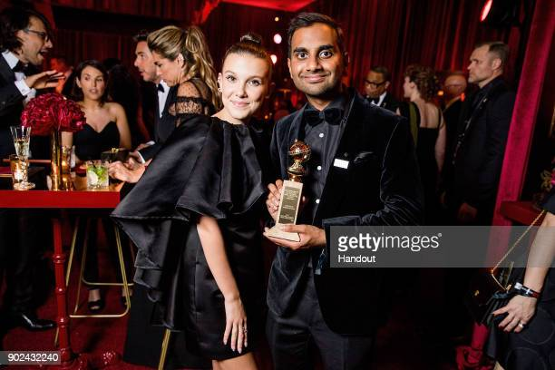 In this handout photo provided by Netflix Millie Bobby Brown and Aziz Ansari attend the Netflix Golden Globes after party at Waldorf Astoria Beverly...
