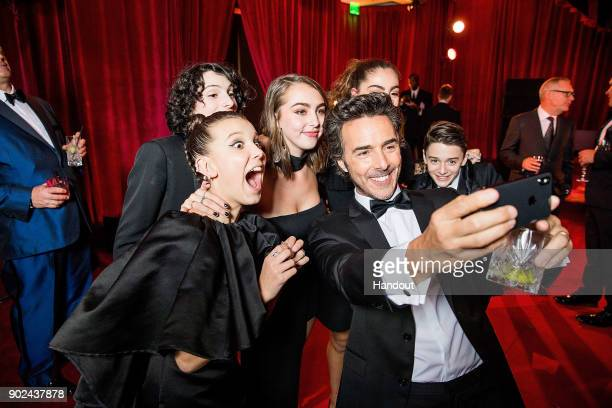In this handout photo provided by Netflix Millie Bobby Brown Finn Wolfhard Shawn Levy and Noah Schnapp attend the Netflix Golden Globes after party...