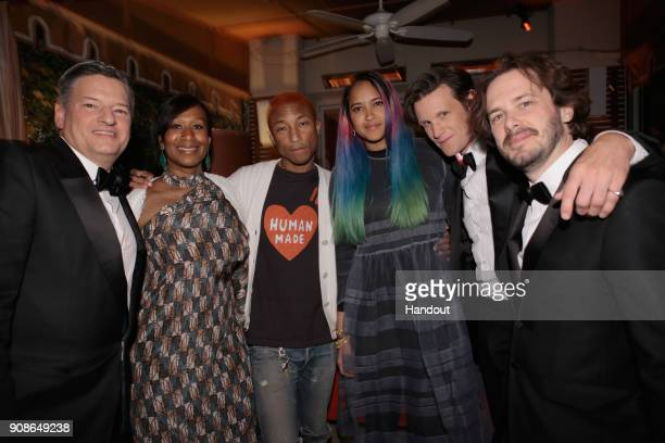 In this handout photo provided by Netflix Netflix Chief Content Officer Ted Sarandos Ambassador to the Bahamas Nicole Avant musician Pharrell...