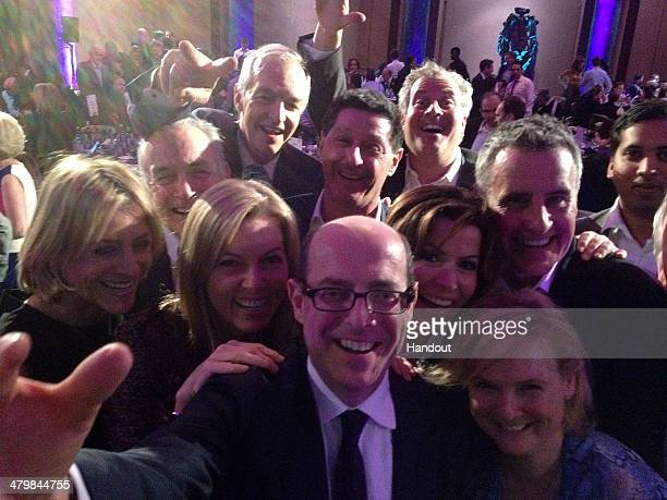 In this handout photo provided by Nick Robinson Nick Robinson takes a 'selfie' with news readers Emily Maitlis Alastair Stewart Mary Nightingale Jon...
