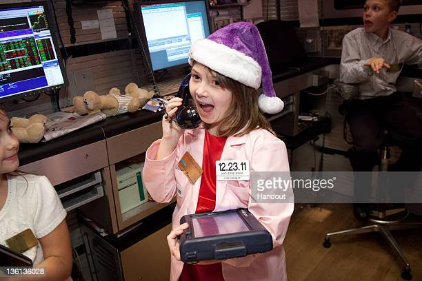 In this handout photo provided by NYSE Euronext MakeAWish Child Katherine Mara from The MakeAWish Foundation of Connecticut visits the New York Stock...