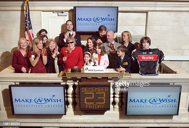 In this handout photo provided by NYSE Euronext MakeAWish child Katherine Mara rings The Closing Bell joined by musician Jose Feliciano as...