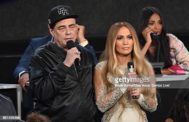 In this handout photo provided by One Voice Somos Live actor Benicio del Toro and singer Jennifer Lopez speak onstage during 'One Voice Somos Live A...