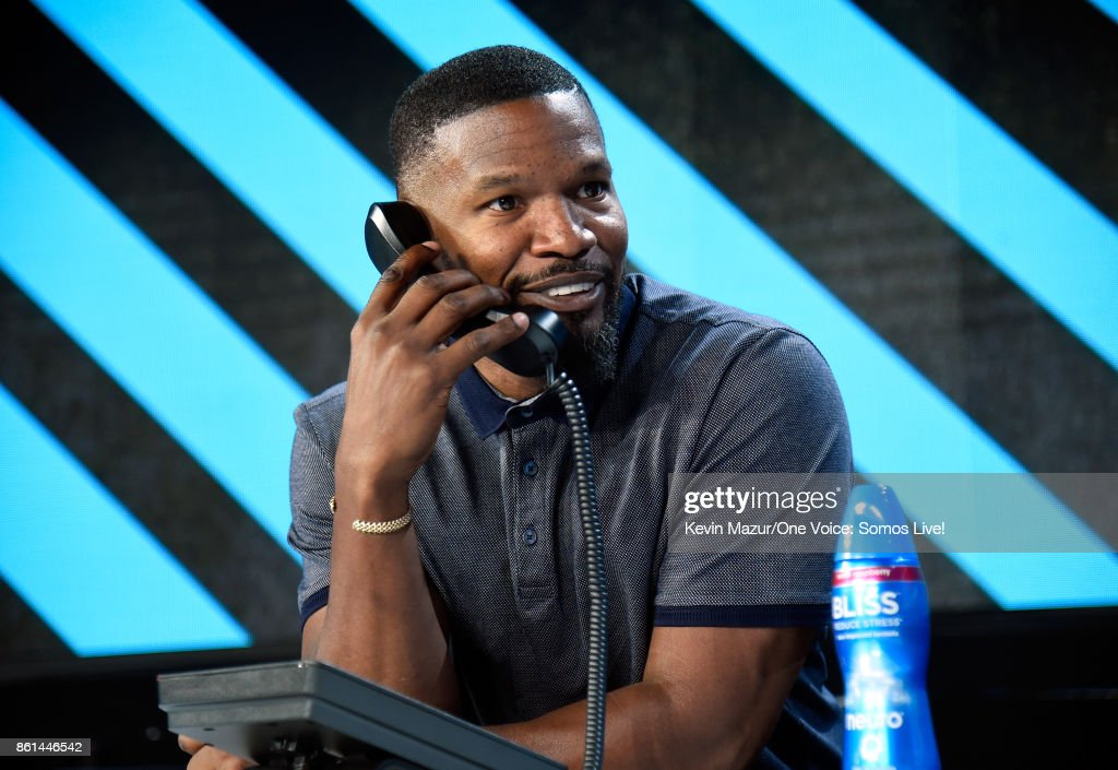 In this handout photo provided by One Voice: Somos Live!, actor Jamie Foxx participates in the phone bank onstage during 'One Voice: Somos Live! A Concert For Disaster Relief' at the Universal Studios Lot on October 14, 2017 in Los Angeles, California.