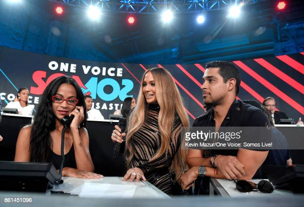 In this handout photo provided by One Voice Somos Live actor Zoe Saldana singer Jennifer Lopez and actor Wilmer Valderrama participate in the phone...