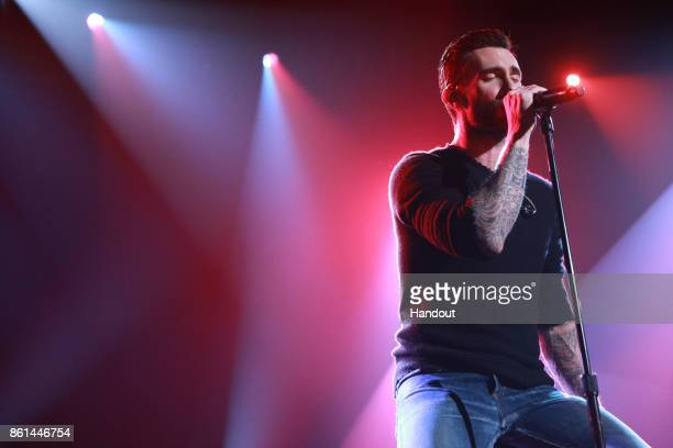 In this handout photo provided by One Voice Somos Live Adam Levine of Maroon 5 performs onstage during One Voice Somos Live A Concert For Disaster...