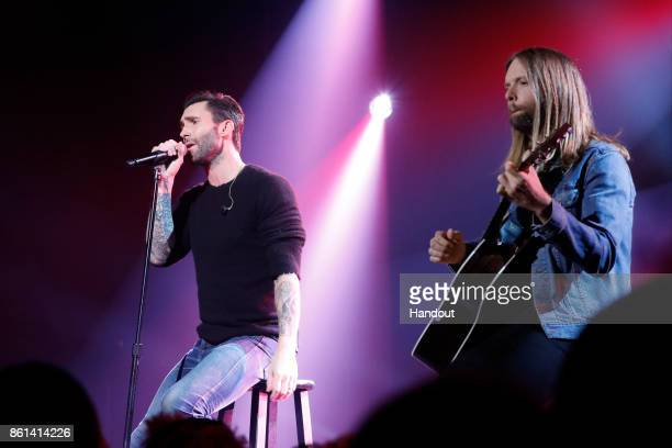 In this handout photo provided by One Voice Somos Live Adam Levine and James Valentine of Maroon 5 perform onstage during One Voice Somos Live A...