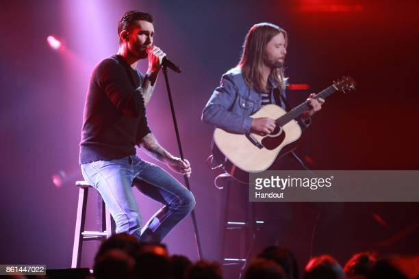 In this handout photo provided by One Voice Somos Live Adam Levine and James Valentine of Maroon 5 onstage during One Voice Somos Live A Concert For...