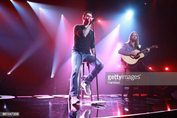 In this handout photo provided by One Voice Somos Live Adam Levine and James Valentine of Maroon 5 peform onstage during One Voice Somos Live A...