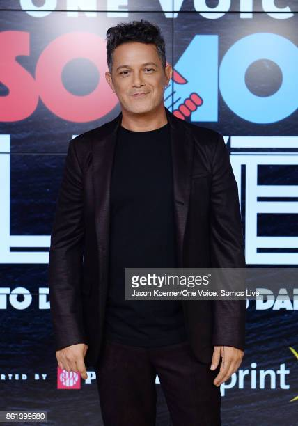 In this handout photo provided by One Voice Somos Live Alejandro Sanz poses in the pressroom at One Voice Somos Live A Concert For Disaster Relief at...
