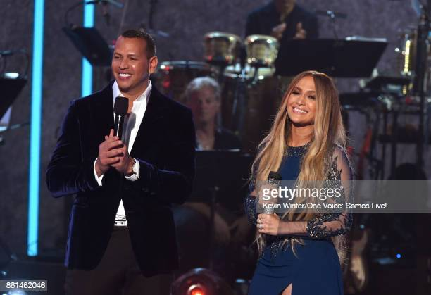 In this handout photo provided by One Voice Somos Live Alex Rodriguez and singer Jennifer Lopez speak onstage during 'One Voice Somos Live A Concert...