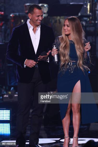 In this handout photo provided by One Voice Somos Live Alex Rodriguez and Jennifer Lopez speak onstage during 'One Voice Somos Live A Concert For...
