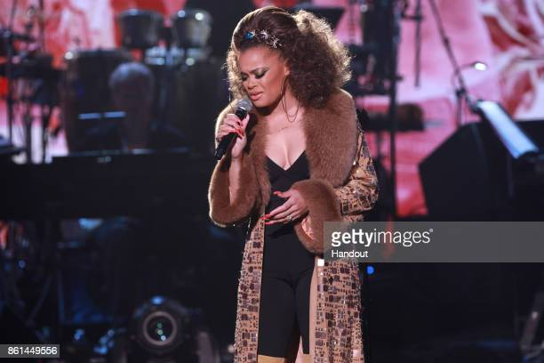 In this handout photo provided by One Voice Somos Live Andra Day performs onstage during 'One Voice Somos Live A Concert For Disaster Relief' at the...