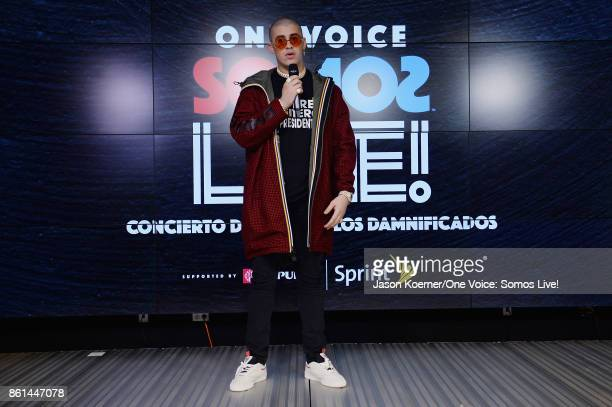 In this handout photo provided by One Voice Somos Live Bad Bunny poses in the pressroom at One Voice Somos Live A Concert For Disaster Relief at...
