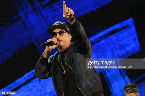 In this handout photo provided by One Voice Somos Live Daddy Yankee performs onstage at One Voice Somos Live A Concert For Disaster Relief at Marlins...