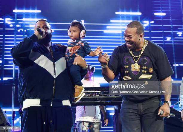 In this handout photo provided by One Voice Somos Live DJ Khaled speaks onstage with son Asahd Tuck Khaled and Busta Rhymes at One Voice Somos Live A...