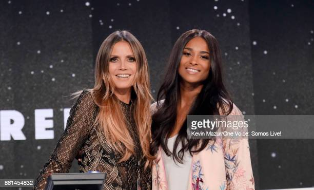 In this handout photo provided by One Voice Somos Live Heidi Klum and singer Ciara participate in the phone bank onstage during 'One Voice Somos Live...