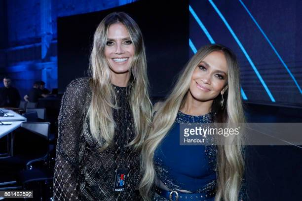 In this handout photo provided by One Voice Somos Live Heidi Klum and Jennifer Lopez participate in the phone bank during 'One Voice Somos Live A...