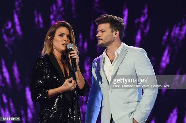 In this handout photo provided by One Voice Somos Live Kany Garcia and Pedro Capo perform onstage at One Voice Somos Live A Concert For Disaster...