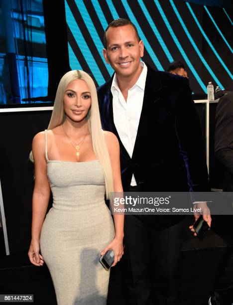 In this handout photo provided by One Voice Somos Live Kim Kardashian and Alex Rodriguez participate in the phone bank onstage during One Voice Somos...