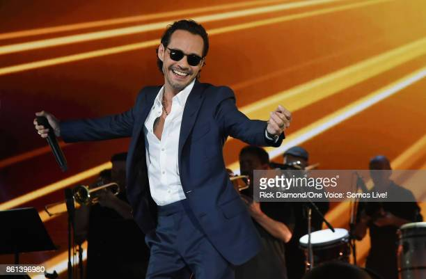 In this handout photo provided by One Voice Somos Live Marc Anthony performs onstage at One Voice Somos Live A Concert For Disaster Relief at Marlins...