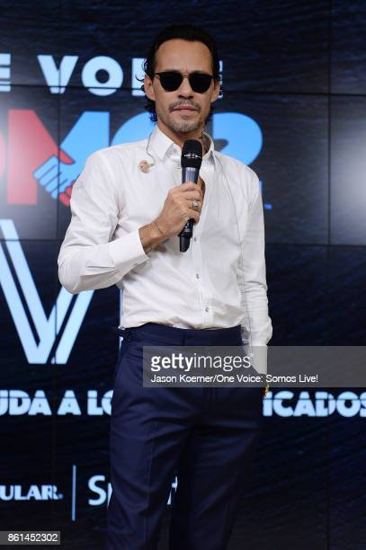 In this handout photo provided by One Voice Somos Live Marc Anthony poses in the pressroom at One Voice Somos Live A Concert For Disaster Relief at...