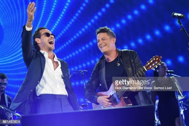 In this handout photo provided by One Voice Somos Live Marc Anthony and Alejandro Sanz perform onstage at One Voice Somos Live A Concert For Disaster...