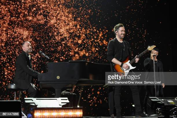 In this handout photo provided by One Voice Somos Live Mario Domm and Pablo Hurtado of 'Camila' perform onstage at One Voice Somos Live A Concert For...