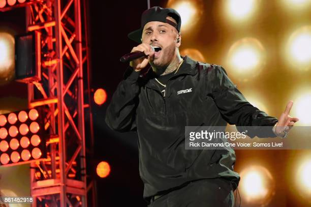 In this handout photo provided by One Voice Somos Live Nicky Jam performs onstage at One Voice Somos Live A Concert For Disaster Relief at Marlins...