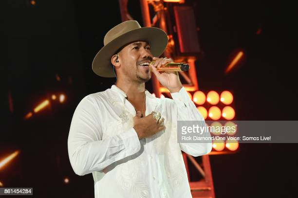 In this handout photo provided by One Voice Somos Live Romeo Santos performs onstage at One Voice Somos Live A Concert For Disaster Relief at Marlins...