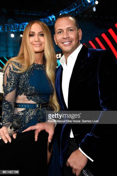 In this handout photo provided by One Voice Somos Live singer Jennifer Lopez and Alex Rodriguez pose onstage during 'One Voice Somos Live A Concert...