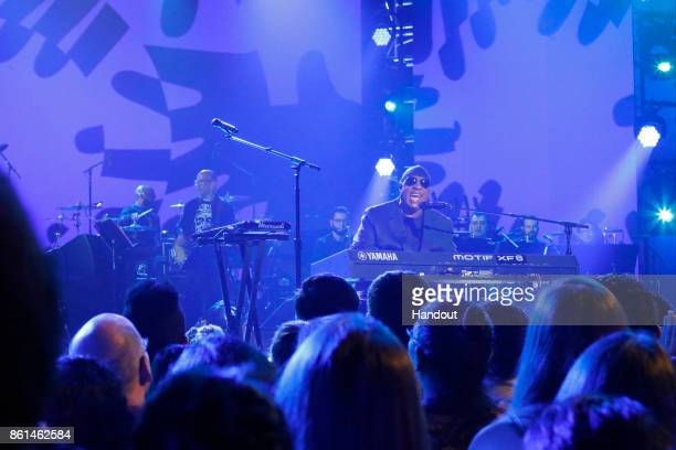 In this handout photo provided by One Voice Somos Live Stevie Wonder performs onstage during 'One Voice Somos Live A Concert For Disaster Relief' at...