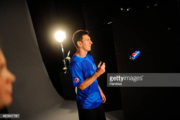 In this handout photo provided by Pepsi Leo Messi poses during a behind the scenes shoot for Pepsi on August 29 2013 in London England