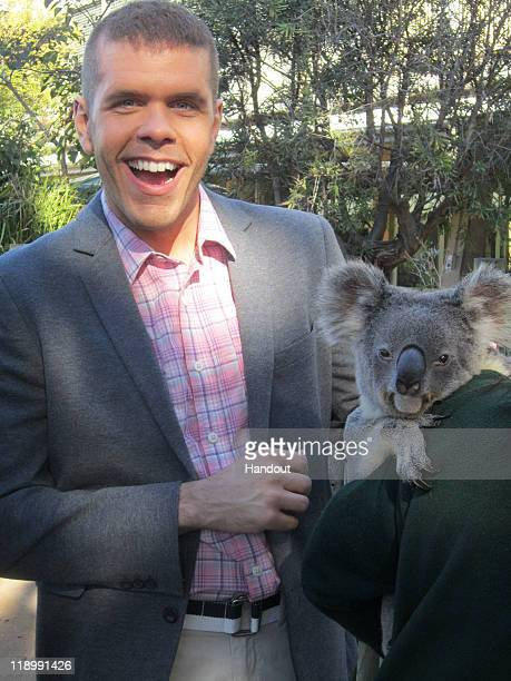 In this handout photo provided by Perezhiltoncom Blogger Perez Hilton poses with a koala during a visit to Taronga Zoo on June 13 2011 in Sydney...