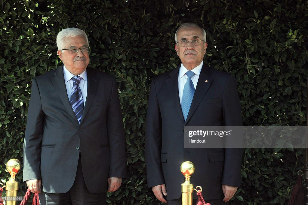 In this handout photo provided by PPO, Palestinian President Mahmoud Abbas (L) meets with Lebanese President General Michel Suleiman on July 3, 2013 in Beirut, Lebanon. Lebanon is now home to the largest number of Syrian refugees who have fled the conflict in that country. Both Lebanon and Syria have also historically hosted significant populations of Palestinian refugees.