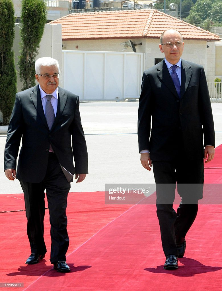 In this handout photo provided by PPO, President Mahmoud Abbas (L) meets with Italian Prime Minister, Enrico Letta (R) on July 2, 2013 in Ramallah, West Bank. In a joint media conference with the Italian Prime Minister, Mahmoud Abbas stated that after a meeting with U.S. Secretary of State John Kerry two days ago, that he is optimistic that the U.S. will succeed in restarting Israeli-Palestinian peace talks.