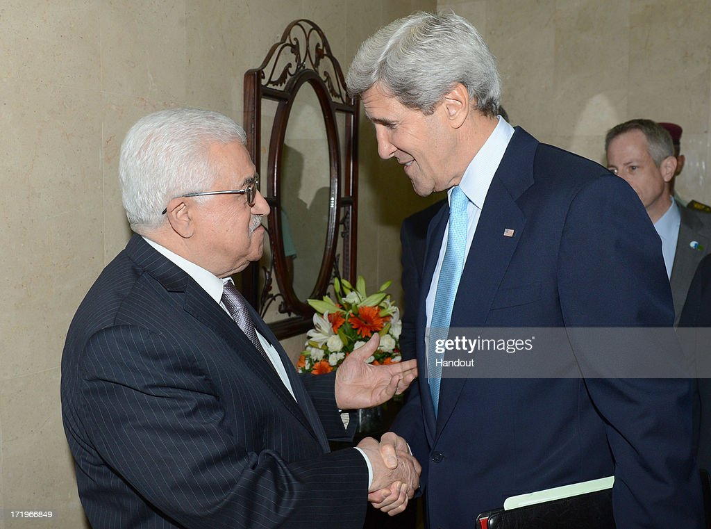 In this handout photo provided by PPO, U.S. Secretary of State John Kerry (R) meets with Palestinian President Mahmoud Abbas on June 30, 2013 in Ramallah, West Bank. Kerry is holding various peace talks with Israeli and Palestinian leaders.