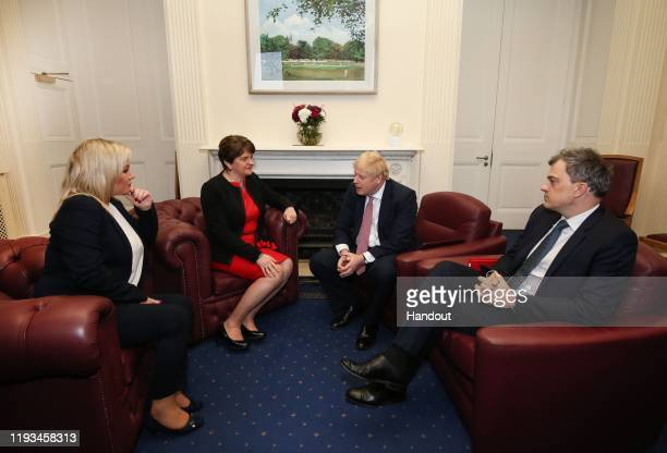In this handout photo provided by Press Eye, First Minister Michelle O'Neill of Sinn Fein, First Minister Arlene Foster of the DUP, British Prime...