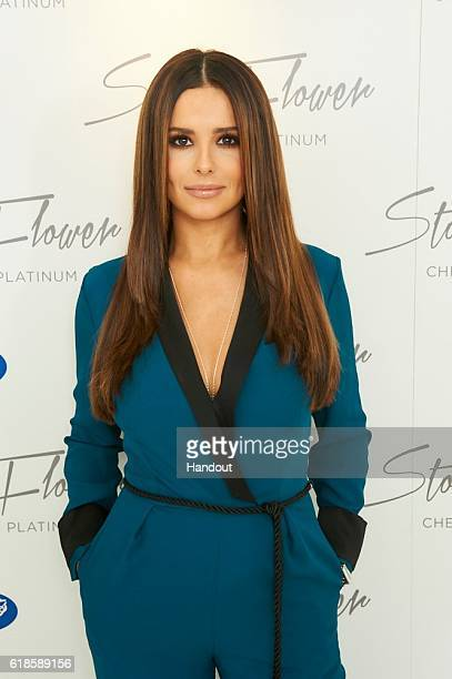 In this handout photo provided by SAS and Company singer Cheryl attends a signing session for her fragrance StormFlower at the Sanderson Hotel on...