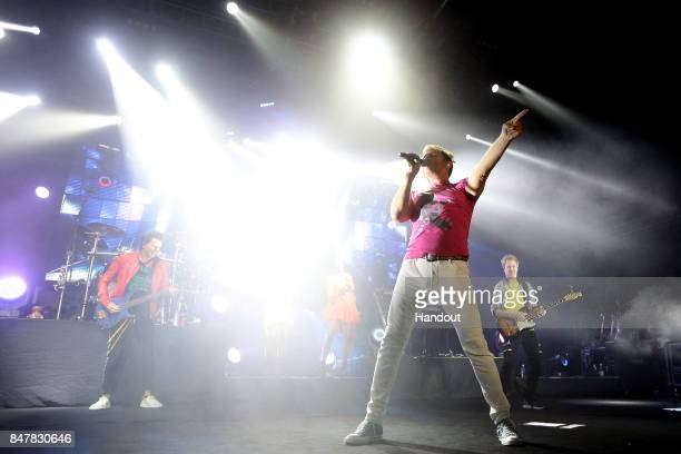 In this handout photo provided by Singapore GP Simon Le Bon of Duran Duran performs on stage during day two of the Singapore Formula One Grand Prix...