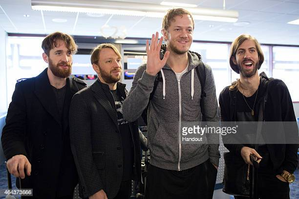 In this handout photo provided by Southwest Airlines Dan Platzman Ben McKee Dan Reynolds Daniel Wayne Sermon of Imagine Dragons get ready to board a...