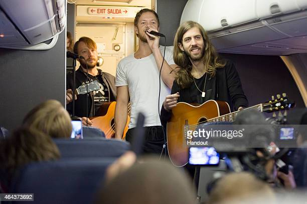 In this handout photo provided by Southwest Airlines Dan Platzman Ben McKee Dan Reynolds Daniel Wayne Sermon of Imagine Dragons perform on a flight...