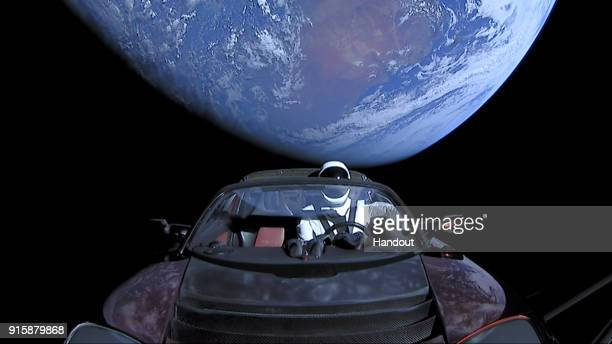 In this handout photo provided by SpaceX a Tesla roadster launched from the Falcon Heavy rocket with a dummy driver named 'Starman' heads towards Mars
