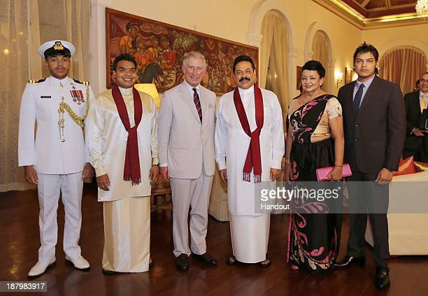 In this handout photo provided by Sri Lankan Government, Prince Charles, Prince of Wales poses with Sri Lankan President Mahinda Rajapaksa and his...