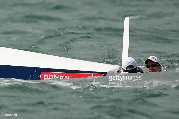 In this handout photo provided by Sydney 2009 World Masters Games Crown Prince Frederik of Denmark and his partner Chris Meehan hold onto their boat...